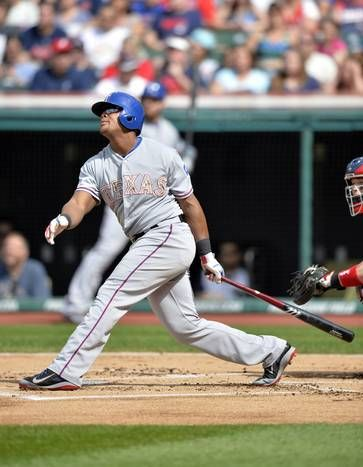 May 25, 2015; Cleveland, OH, USA; Texas Rangers third baseman Adrian Beltre (29) hits a solo home run in the first inning against the Cleveland Indians at Progressive Field. Mandatory Credit: David Richard-USA TODAY Sports