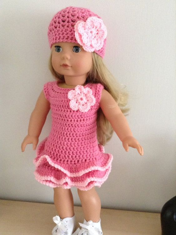 This pattern is for a dress and hat set. It uses dk yarn and a 4mm ...