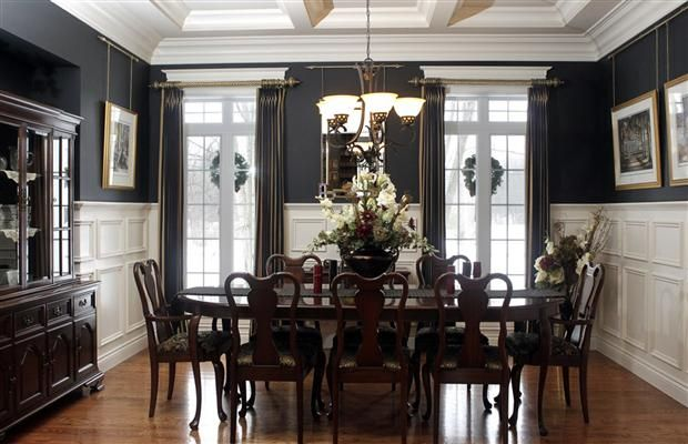 The Dining Room Oozes Elegance With Black Walls Benjamin Moore Satin 54 Inch High Wainscotting Elaborate Crown Moulding Coffered Ceiling And