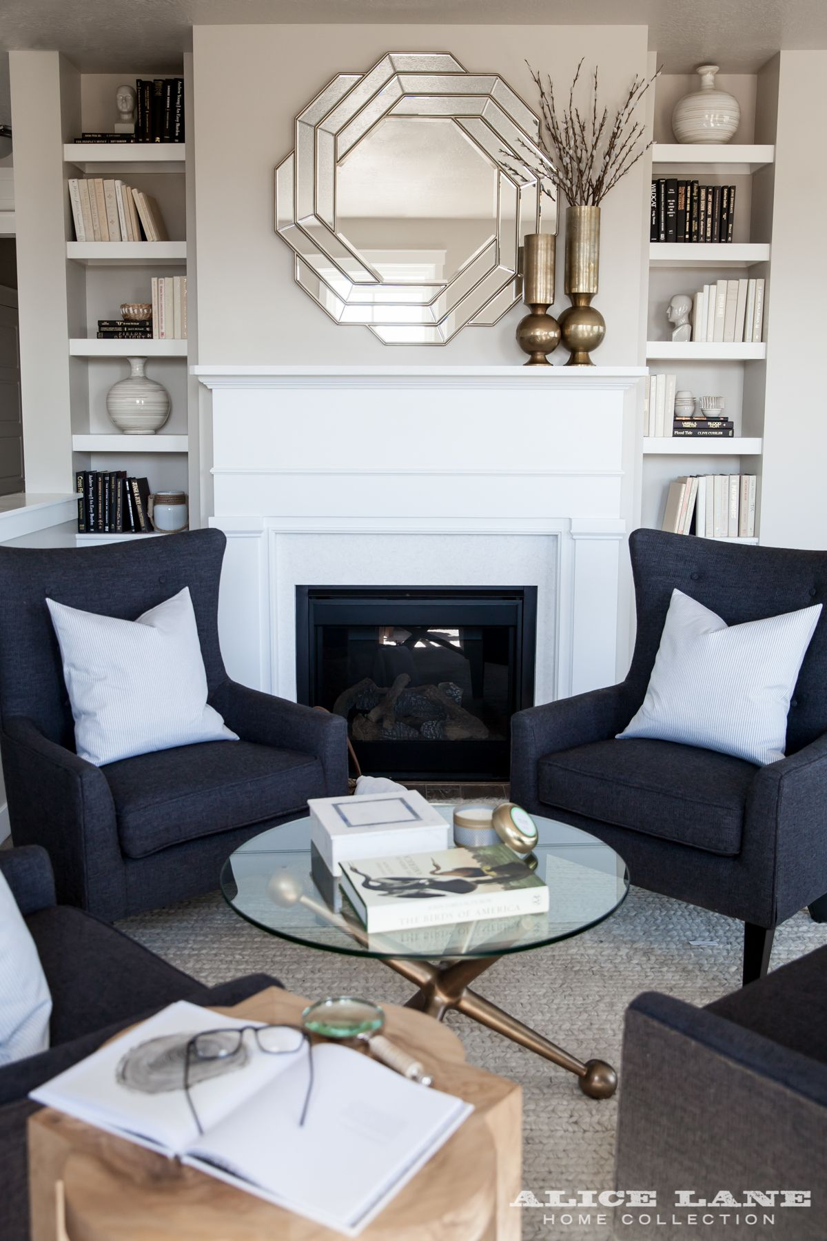 a cozy wood fireplace flanked by shelving itu0027s a cottage retreat with arm chairs beside