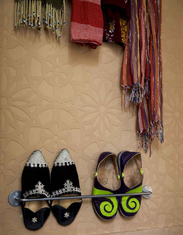 Use towel rails to hold shoes.