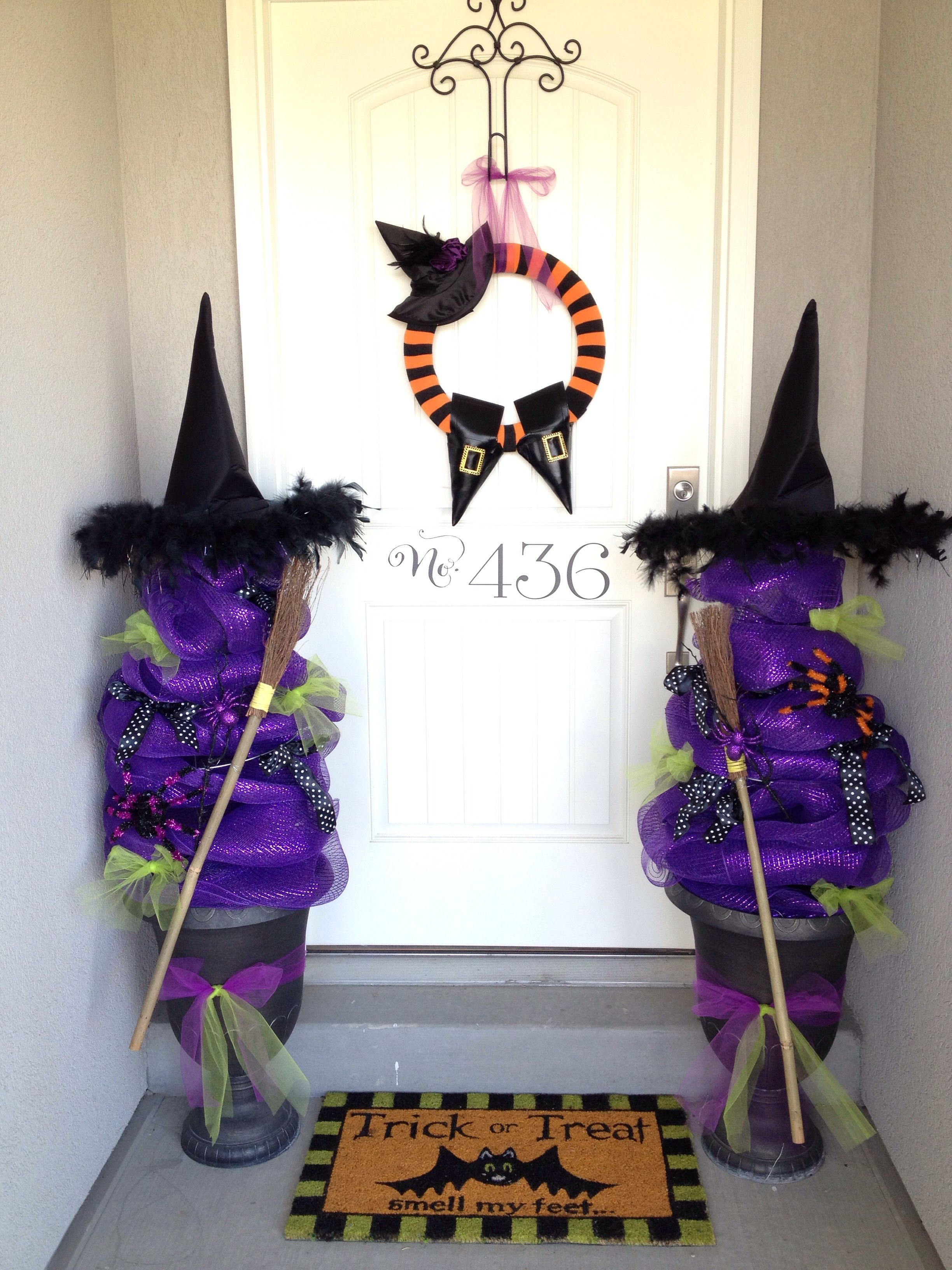 halloween porch decor made from recycled tomato cages and deco mesh