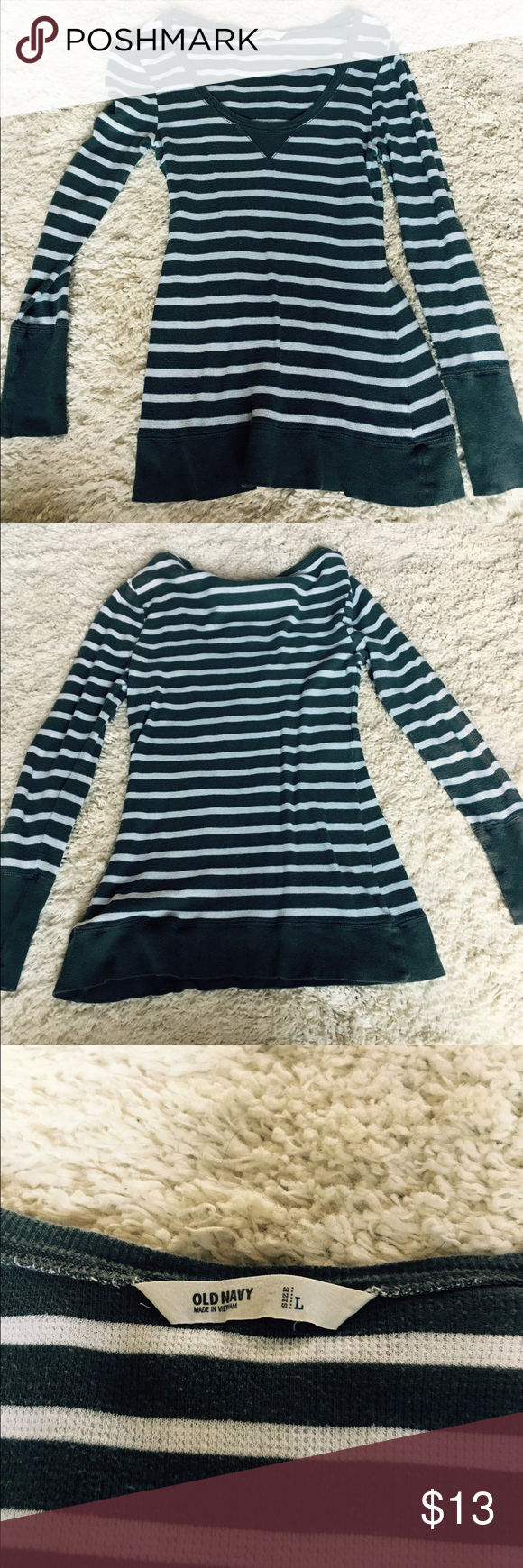 """Summer sweater Longsleeved light summer sweater in grey and white stripes with a V neckline. This top fits loosely and is a great accessory to tie around your shoulders until it gets chilly on those summer nights. Measures 29"""" from shoulder to hemline. Old Navy Sweaters V-Necks"""