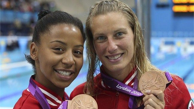 Canada's first medal...a bronze. Emelie Heymans and Jennifer Abel.  Emelie's 4 medal in her 4 consecutive Olympics
