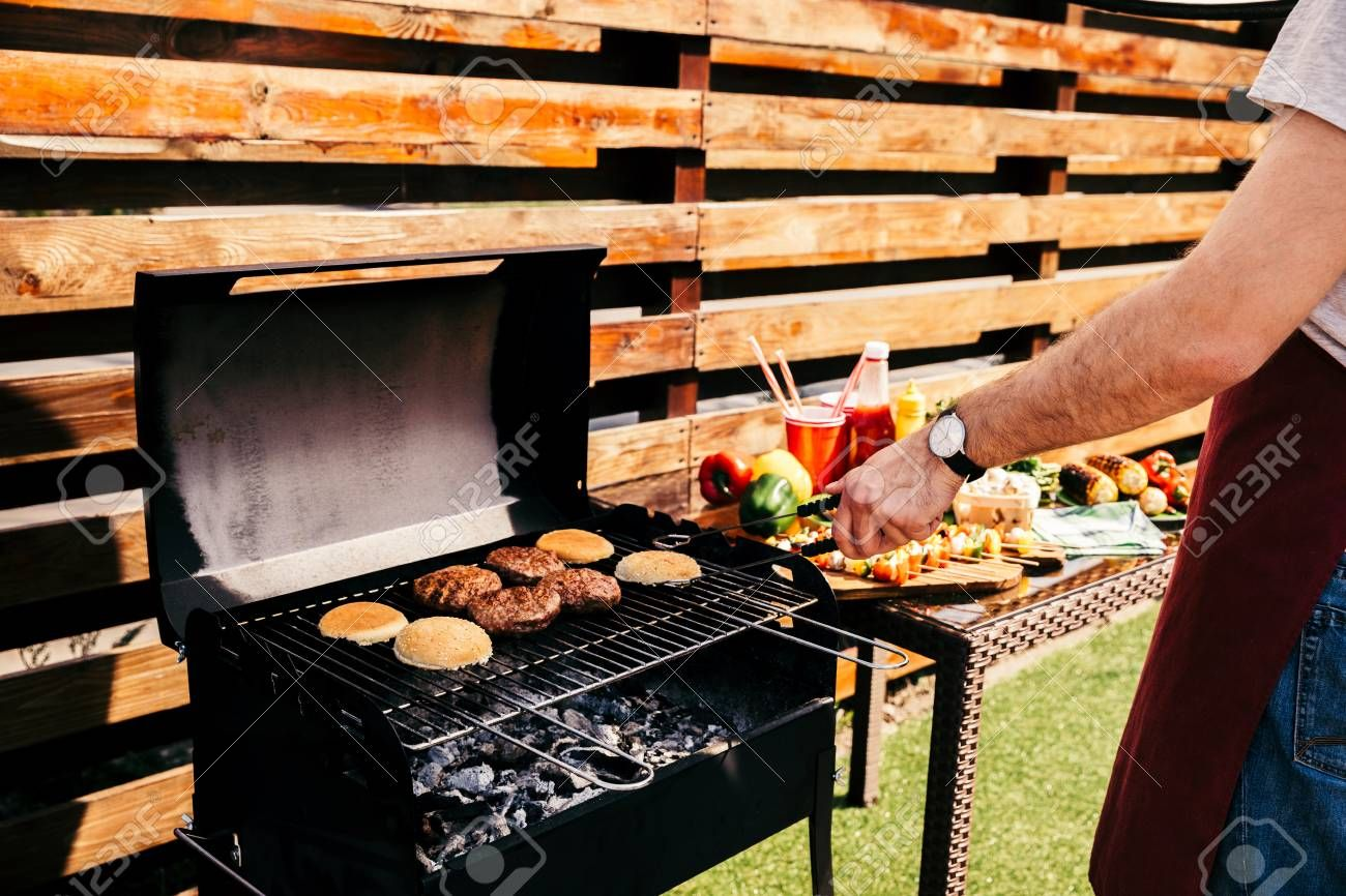 Man cooking grilled meat burgers for outdoors barbecue Stock Photo , #AFF, #grilled, #meat, #Man, #cooking, #burgers