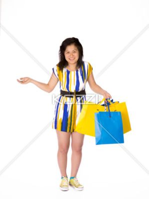 asian young woman with shopping bags. - Portrait of a young Asian woman with shopping bags standing over white background, Model: Shiying Lu