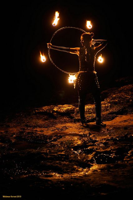 Fire hooping, one of the many beautiful ways to play with fire