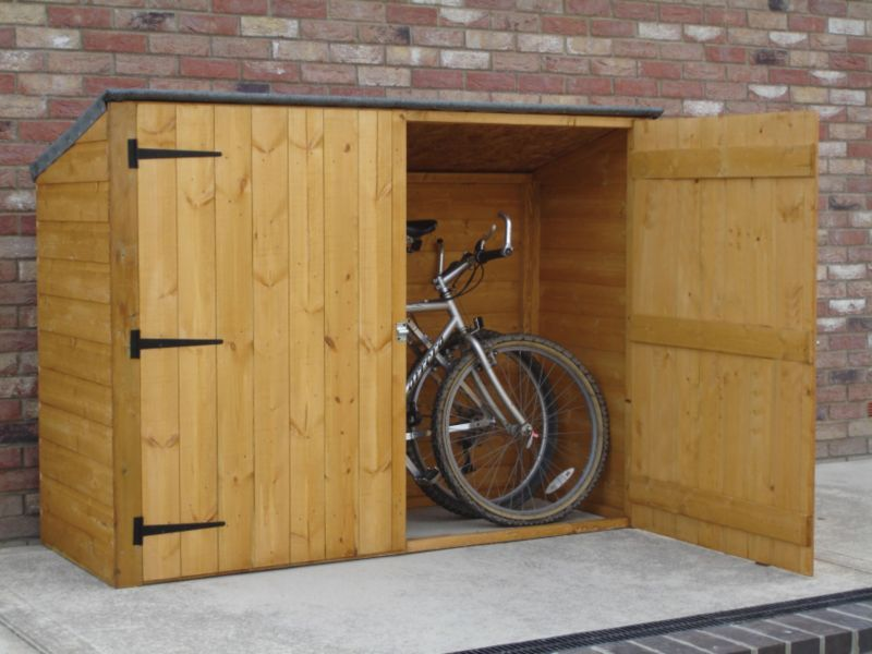 DIY backyard bike shed. I SOOO need this to clear room for the garage. except bigger since I tend to collect bikes.