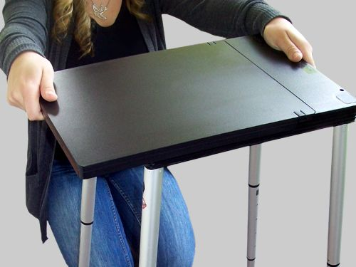 Portable standing desk. I'm not sure what to think about this, but I thought it was worth noting.