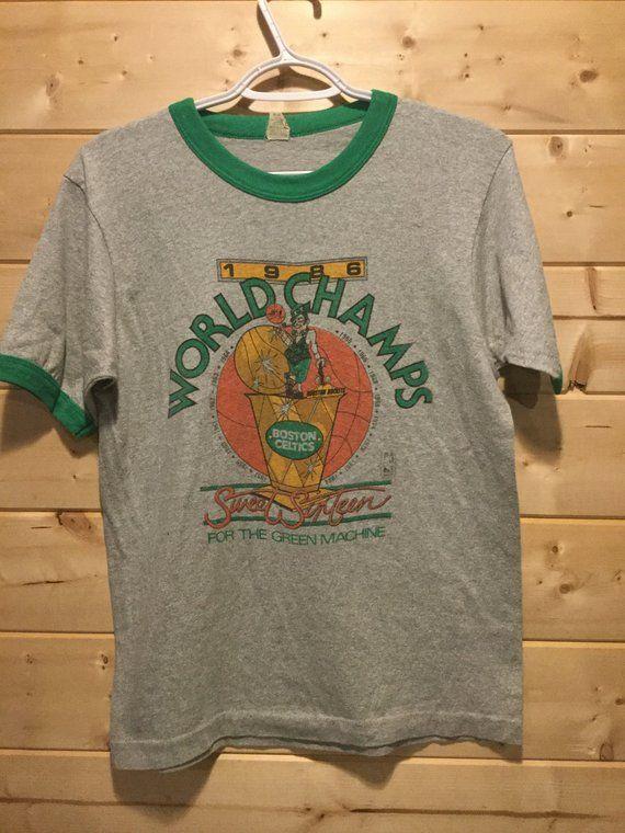 5516ee9bf325 Vintage 1980 s Larry Bird World Champions Ringer Boston Celtics 50 50  Ringer T-Shirt