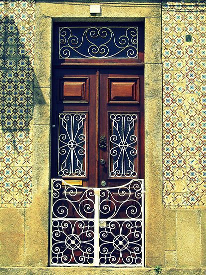 Wooden door with swirly white railings, Tomar, Portugal by juliedawnfox