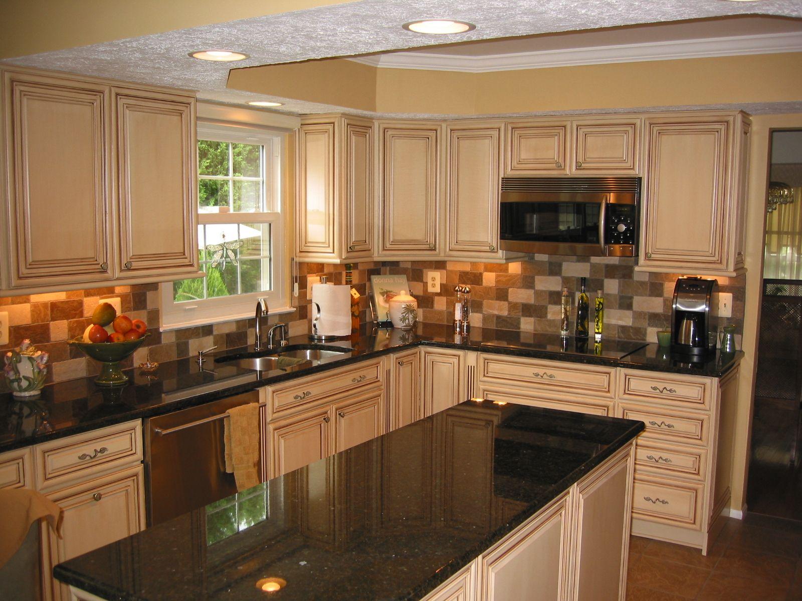 glazed kitchen cabinets, granite countertops, porcelain tile
