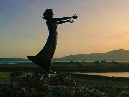 rosses point sligo ireland a bronze statue of a girl with