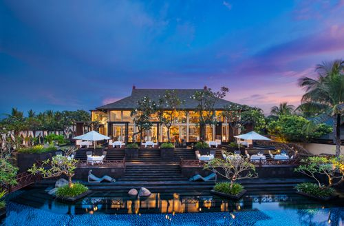 the exterior of kayuputi restaurant at dusk st regis bali pinterest
