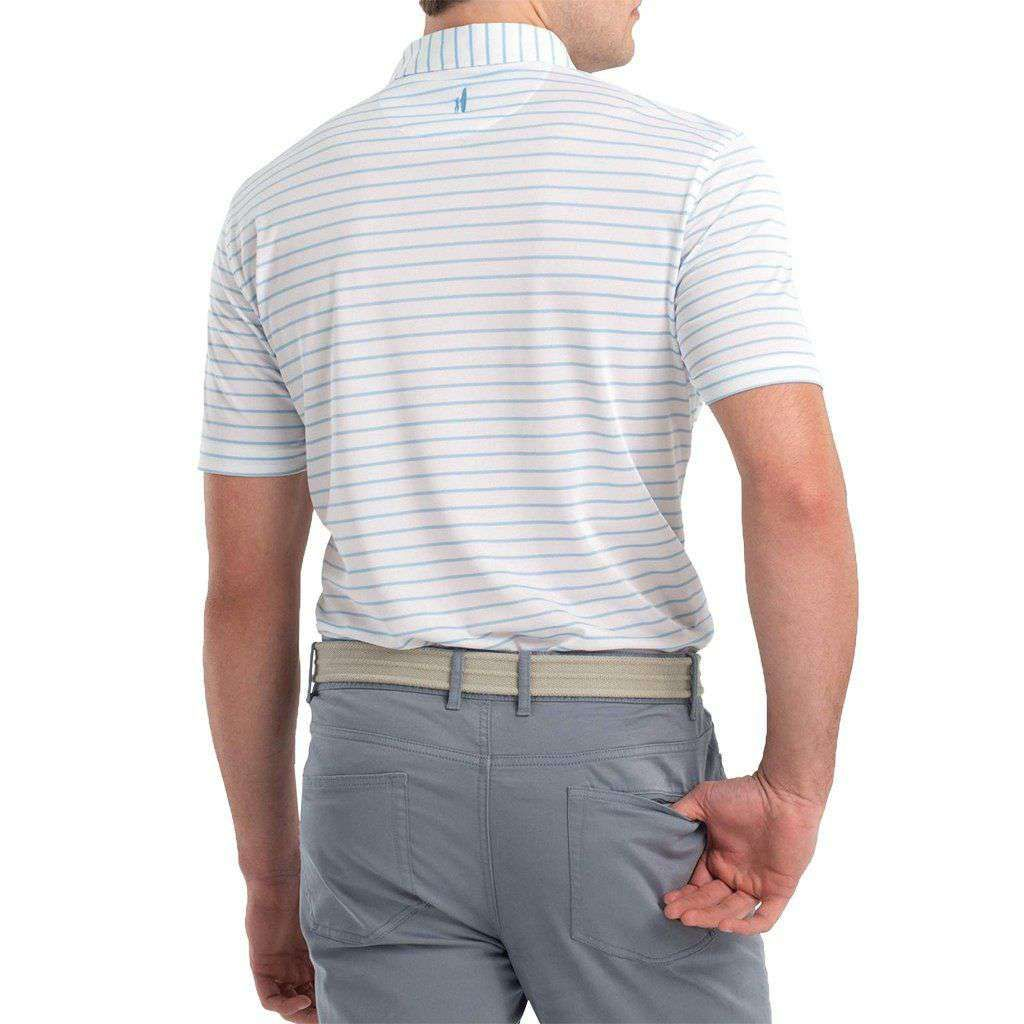 94% polyester / 6% spandex stretch pique Striped PREP-FORMANCE 4-button polo Side vents Logo at center back yoke UPF50 Moisture-wicking Machine-wash Imported Benefits Oxford stripes are aesthetically pleasing to everyone Great polo for golfing and casual Friday's or both Sun protection qualities woven directly into the fabric Moisture wicking properties keep you cool and dry