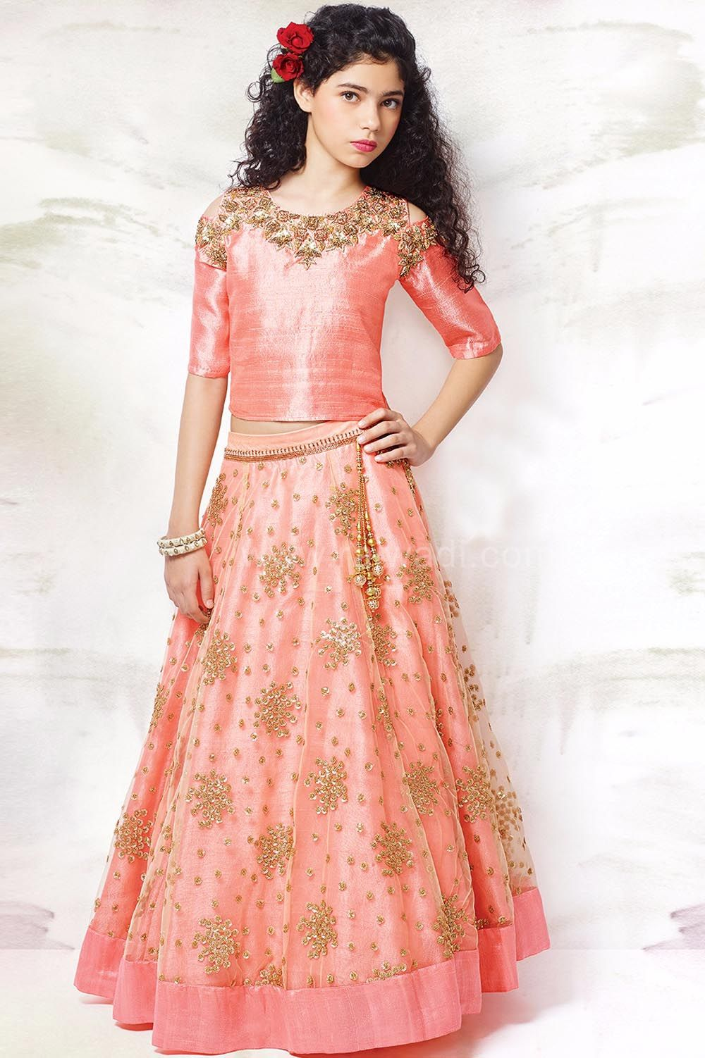 Beautiful Peach Color Silk And Net Fabric Lehenga With Golden