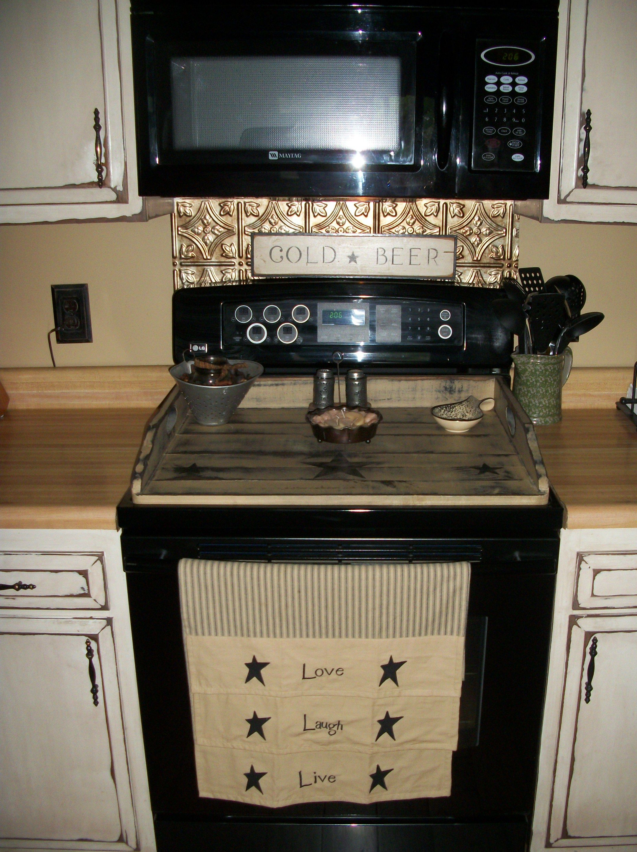 Love the stove board and the towel, well that sign on the stove is ...