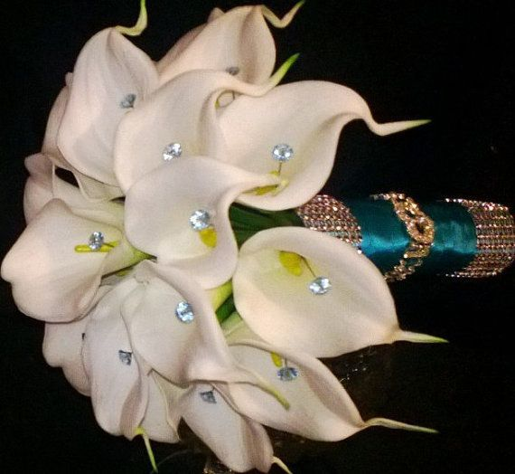 Our Real Touch Calla Lily Bouquets wrapped in Malibu Blue with Rhinestone wrap, and a Heart Rhinestone Bouquet Bracelet with blue diamante pins.