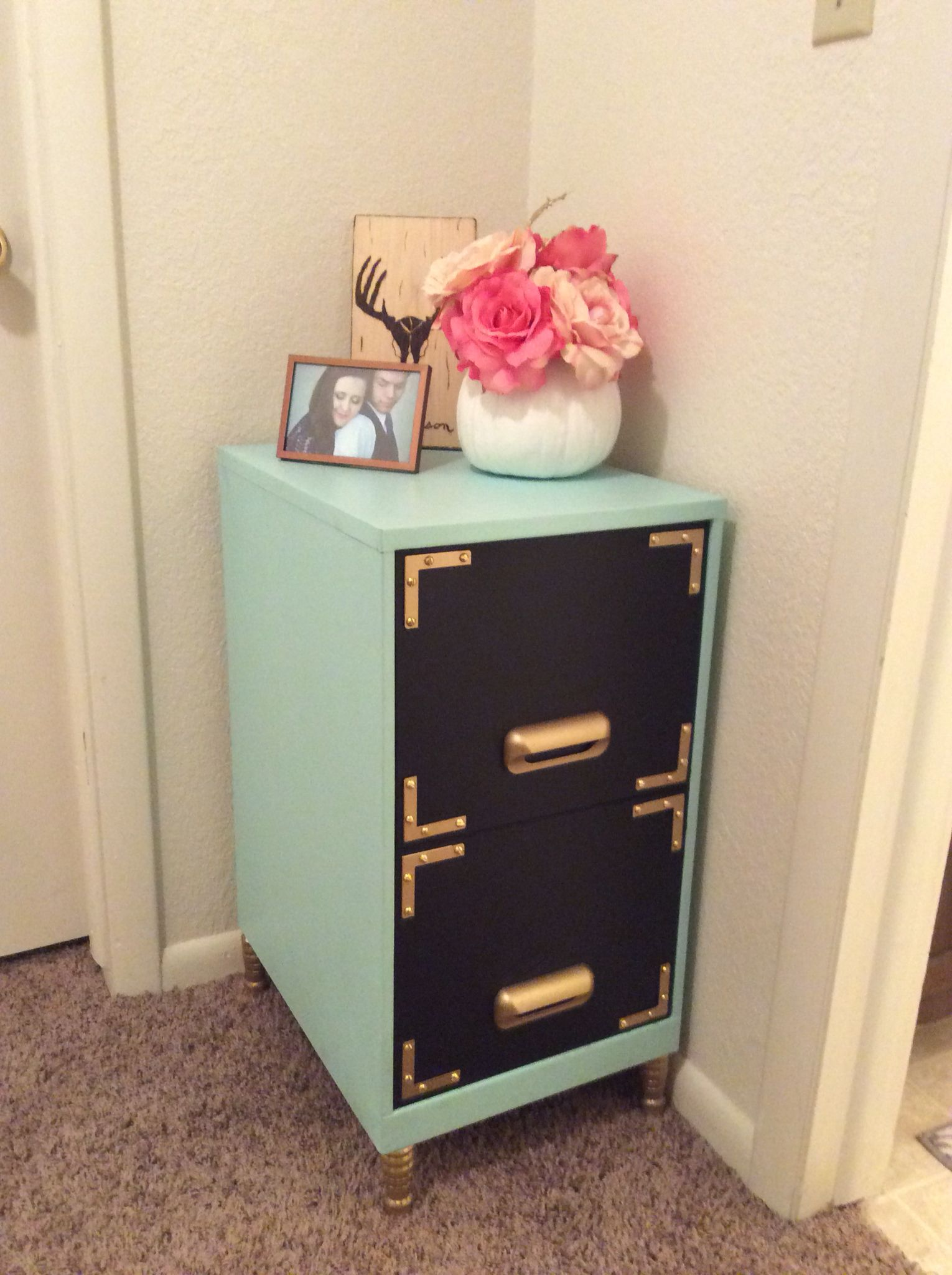 Filing cabinet makeover Black chalkboard paint on the drawers More