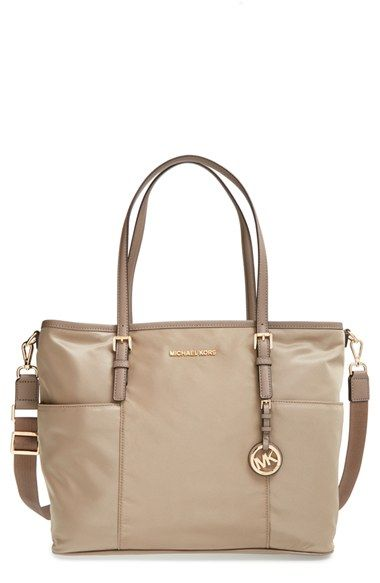 e2353fe96d11 Free shipping and returns on MICHAEL Michael Kors 'Jet Set' Large Diaper Bag  at Nordstrom.com. Raised logo letters grace the topline of a large, ...