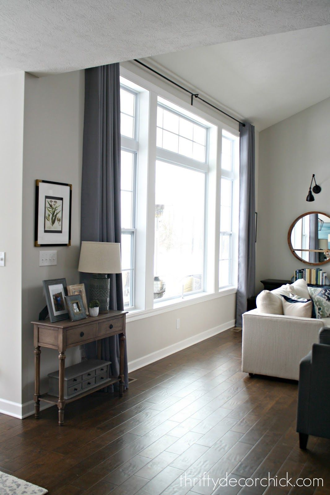 Hardware And Drapes For Big Windows That Don T Break The Bank Big Windows Living Room Picture Windows Living Room Living Room Windows