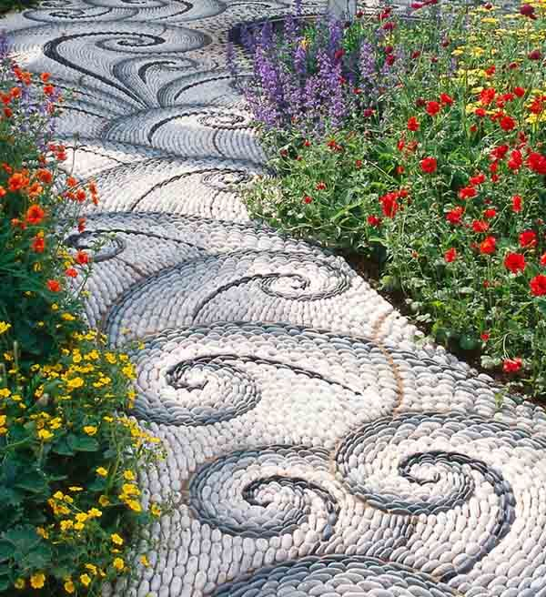 swirly  funky  cool path in gray and white  river rock landscaping ideas
