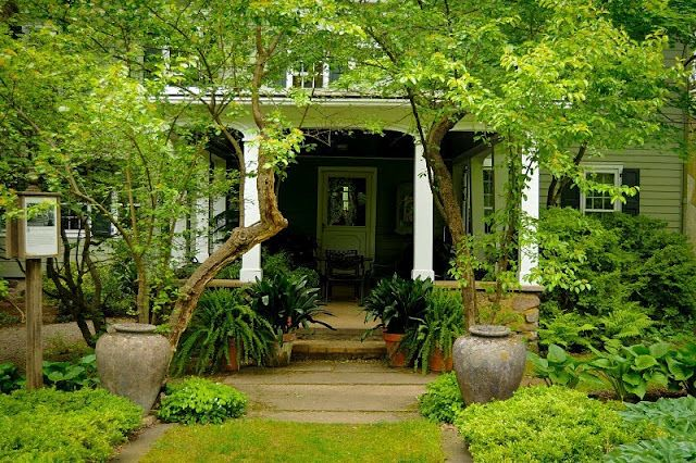 So green, like this entrance and very inviting for me to sit on the porch.