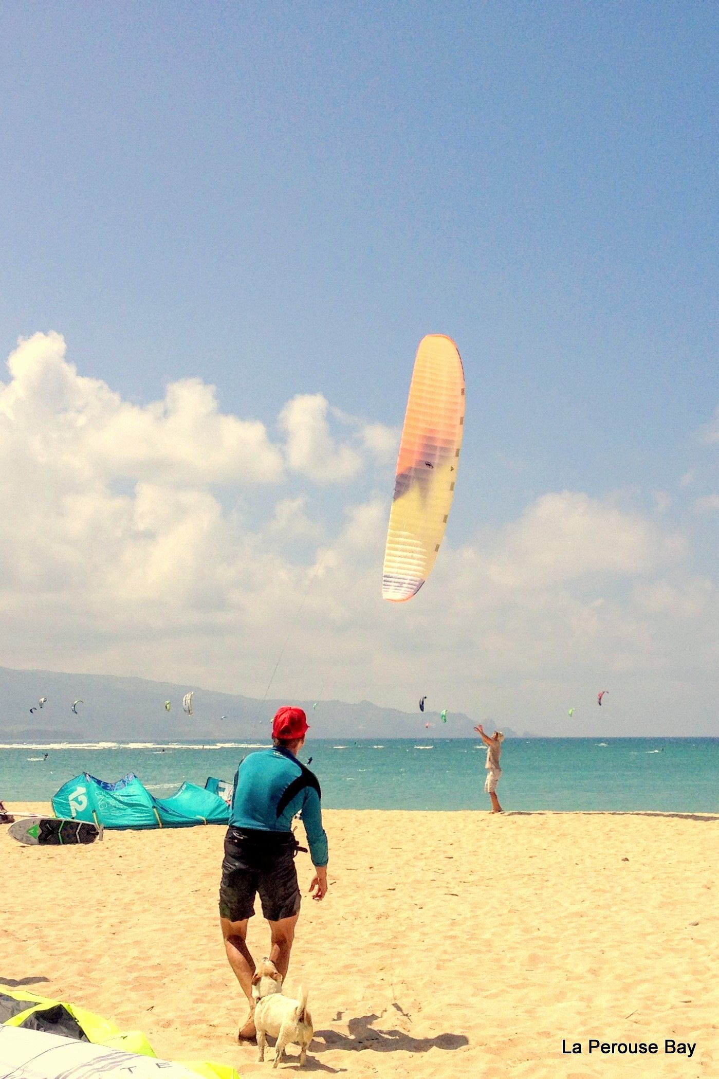 Beautiful day at Kanaha beach, Maui. Foil kite � checked, Foil board checked, steady wind � checked, friends � checked.