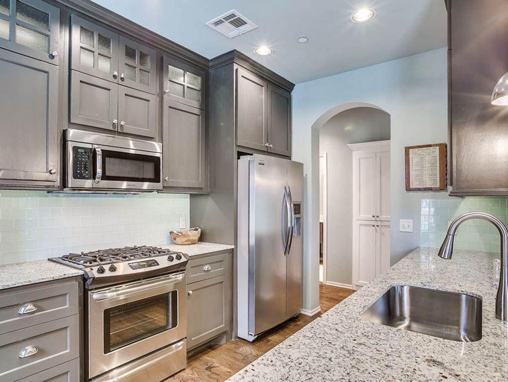 Granite Countertops Ornamental White With Grey Cabinets