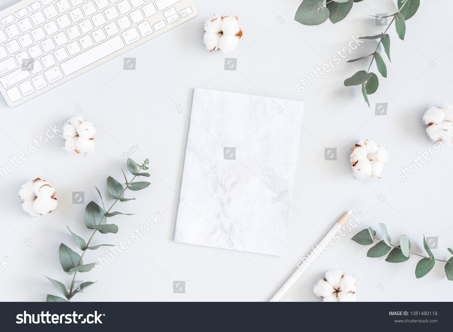 Workspace with computer, marble paper blank, cotton