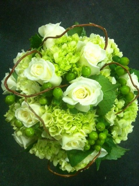 Bride's bouquet I designed with cream Roses, green miniature Hydrangeas & Hypericum berries and curly willow accents.
