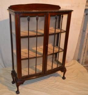 A 1920 S Mahogany Low Bow Fronted Display Cabinet Having
