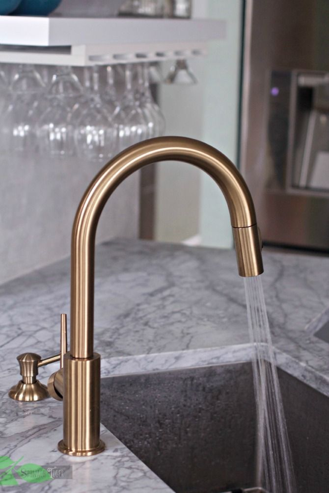 Gold Kitchen Faucet High Chairs Delta Super Chic And Functional Best Spinach Spray From Tiger