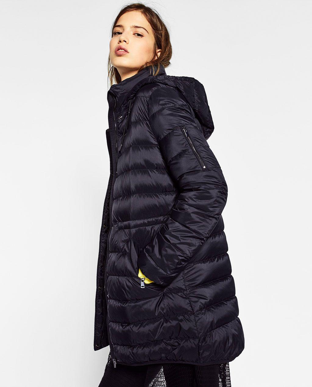 Compra abrigos de pluma de ganso de las mujeres online al