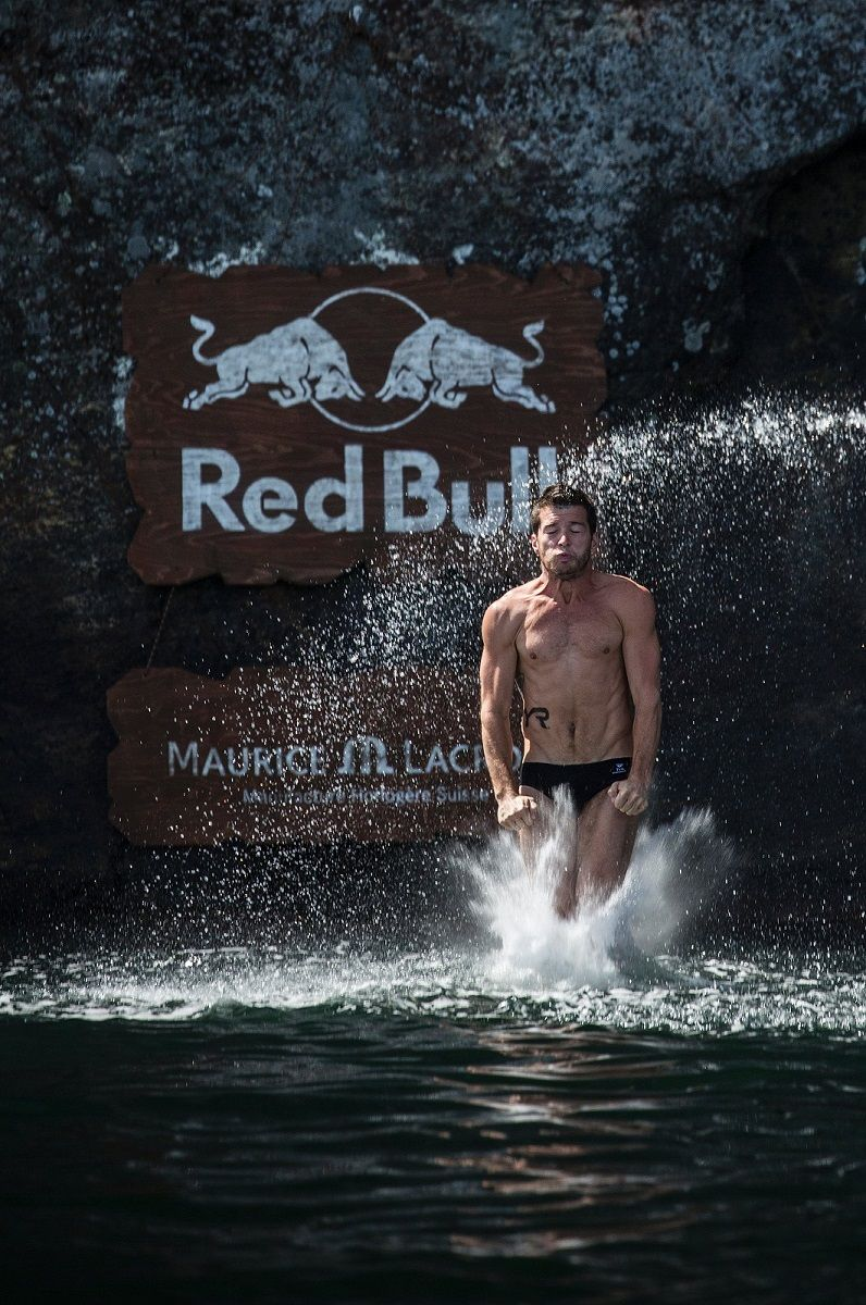 How do cliff divers survive the impact?
