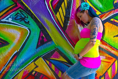 The colors here may be too extreme for you, if there is even a graffiti wall to be had. It sure wouldn't be the norm for maternity pics.  I guess that is why I kind of like it.  We have a cool wall here and I did some of Ryan by it.  A different type of shoot, but they were awesome.