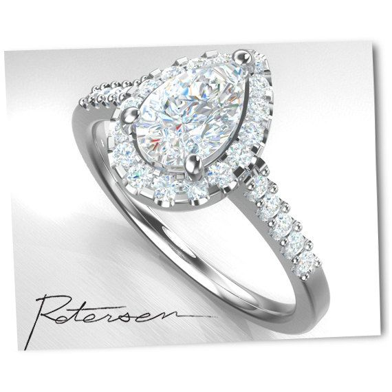 3e61ac44a6d This petit 1 carat Pear Cut Engagement Ring / Wedding Ring features a large  6x5mm (