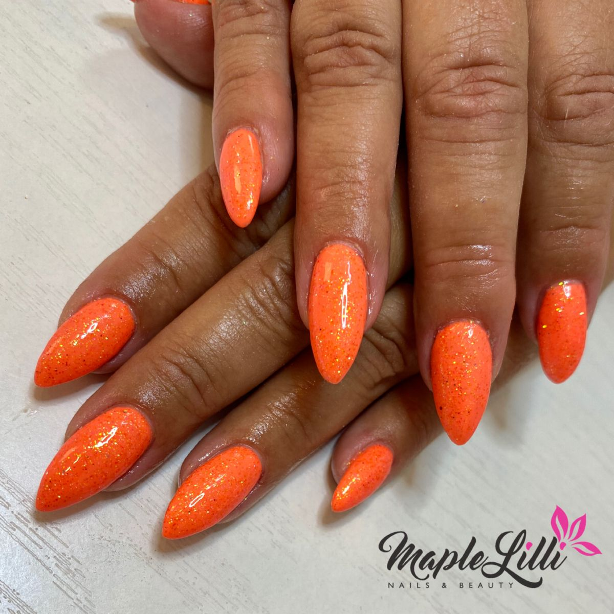 Holiday time. Peach by @thegelbottleinc with an irridescent twist. #nails #nailsofinstagram #orangenails #holiday #sun #thegelbottle #acrylicnails #acrylic