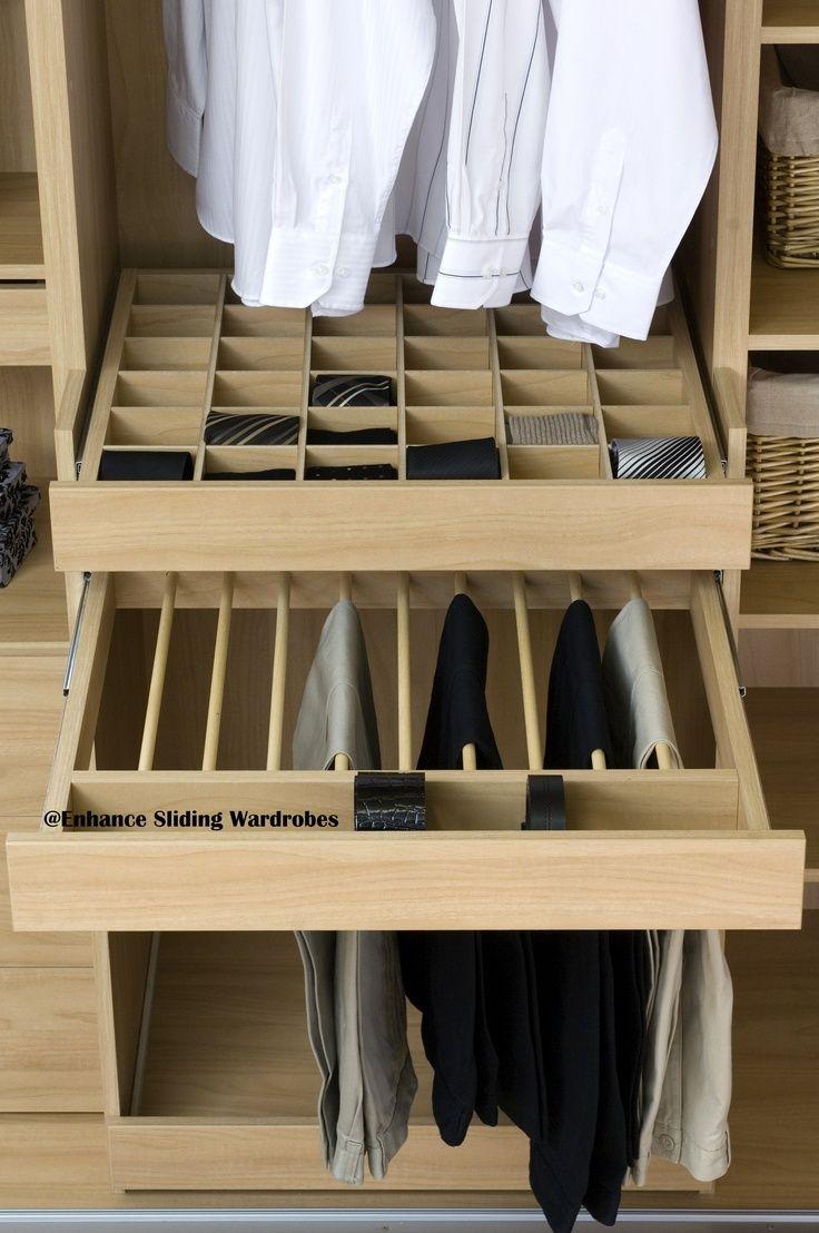 Oak interior of fitted wardrobe with divided drawer, trouser hanging and pull out shoe shelf #storage #wardrobe // Designed by Enhance Sliding Wardrobes www.enhanceslidingwardrobes.com
