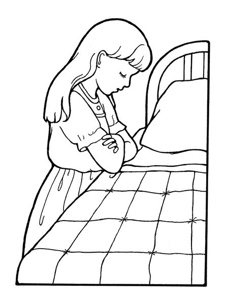 A picture of a girl praying by her bedside before bed