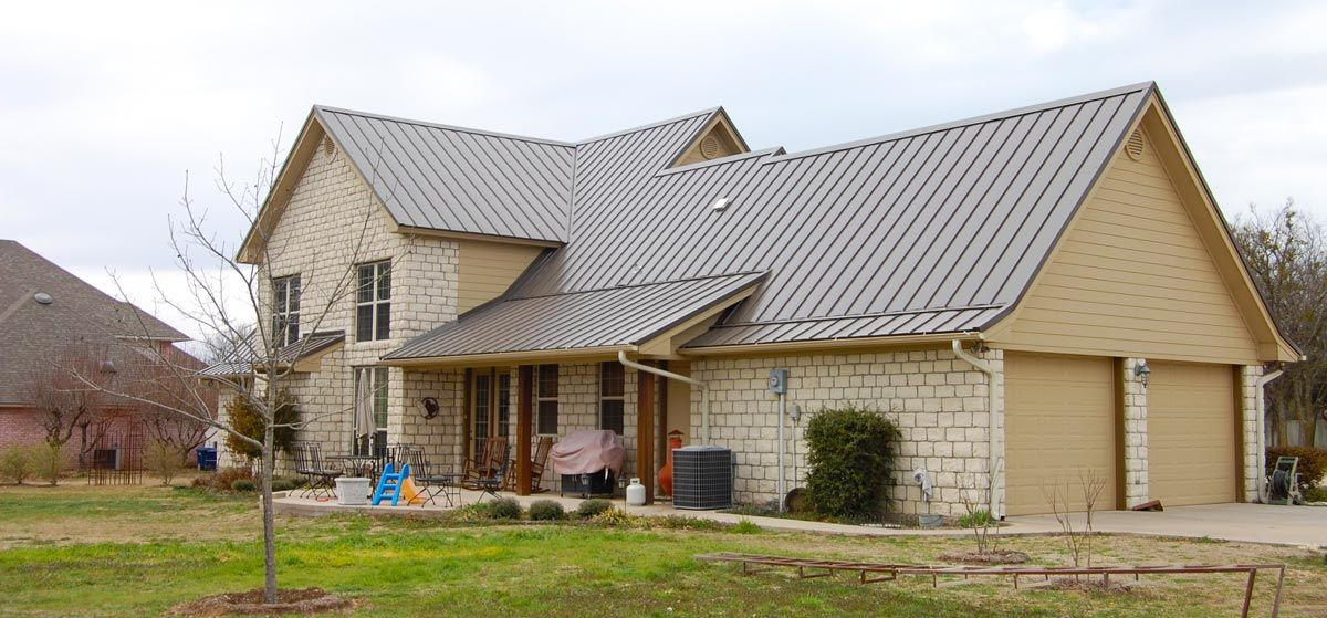 White metal building silver roof many types of for Metal roof home plans