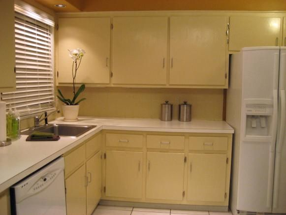 Bored With Your Kitchen S Backsplash Make A New One With Upholstery Fabric A Painting Kitchen Cabinets Old Kitchen Cabinets Painting Laminate Kitchen Cabinets