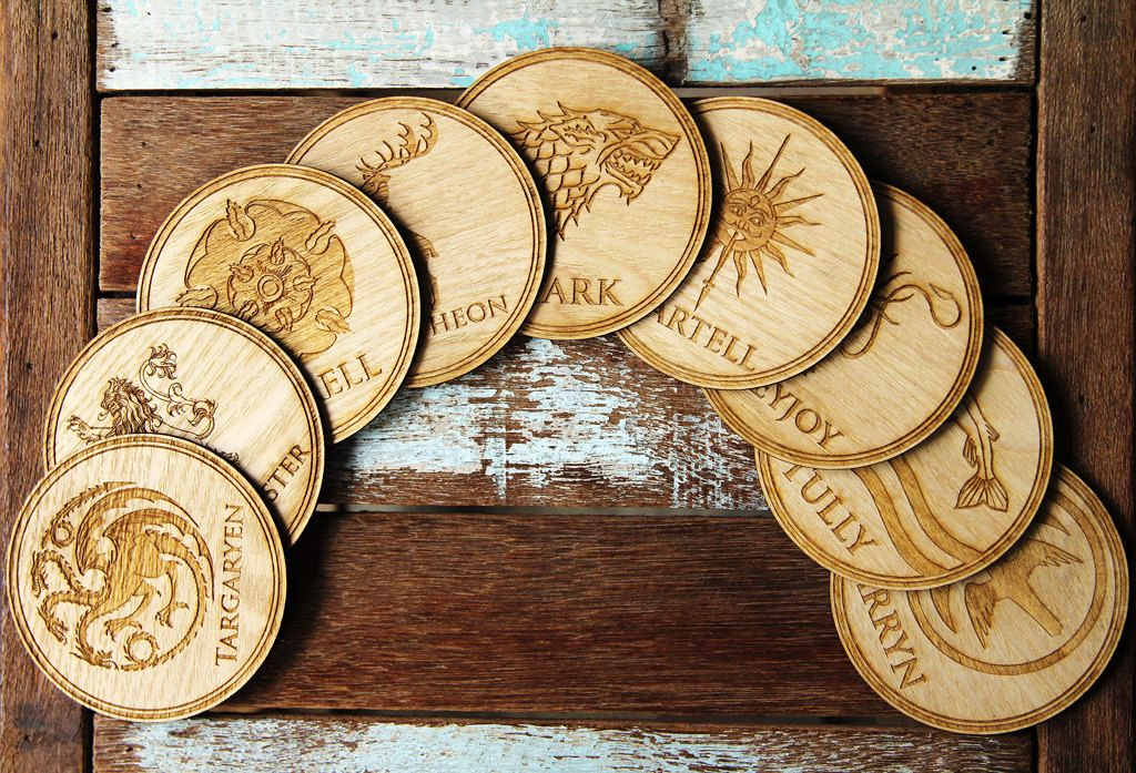Game of Thrones Coasters set, High Quality Engraved on round wood shape. by BiigBrownBear on Etsy https://www.etsy.com/listing/233022685/game-of-thrones-coasters-set-high