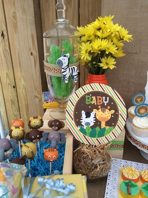Cake pops and decor at a Safari Baby Shower Party! See more party ideas at CatchMyParty.com!