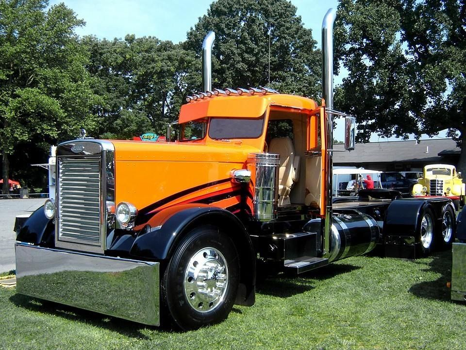 Orange and black old school Peterbilt Big rig trucks