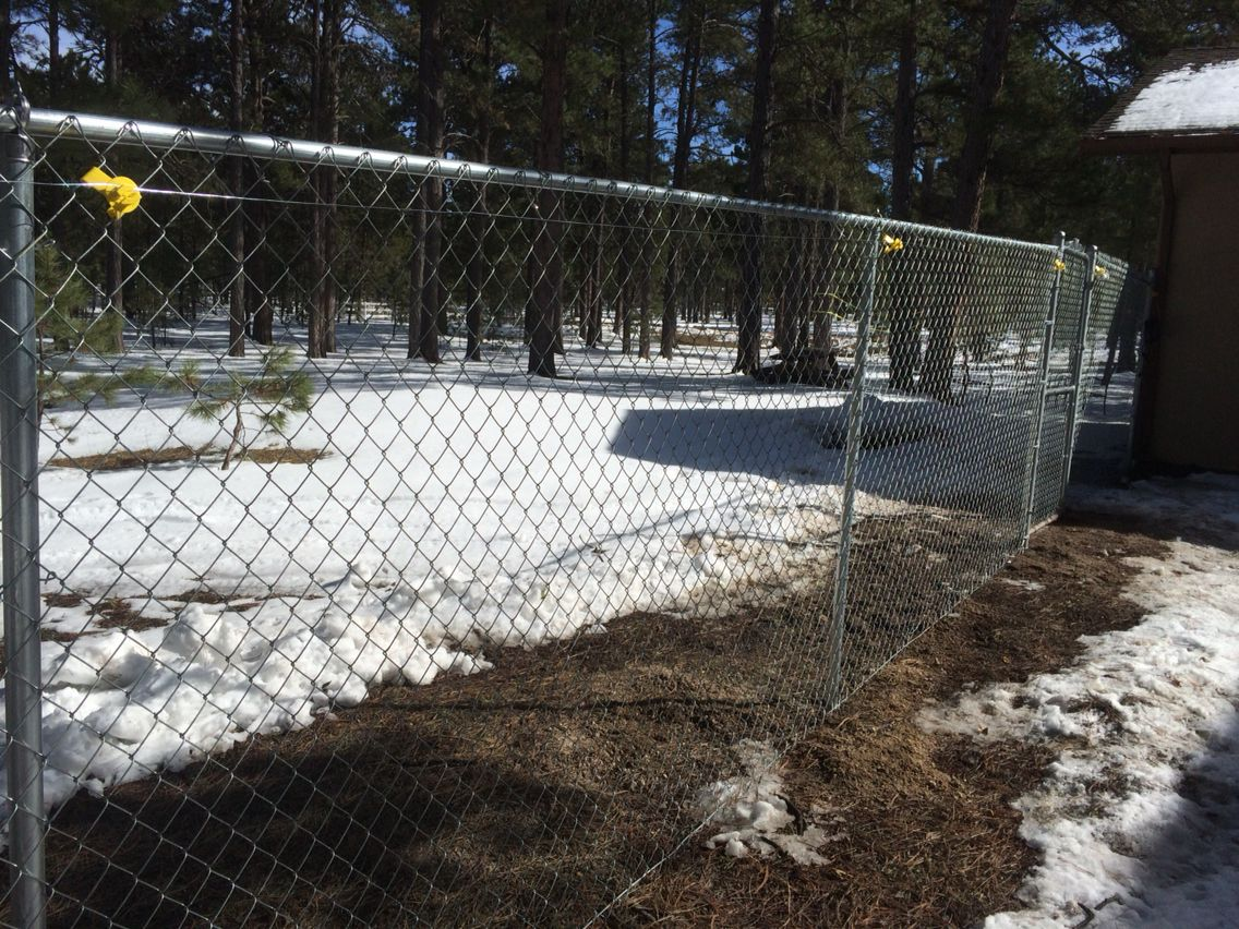 6\' residential chain link fence with electric wire on top ...