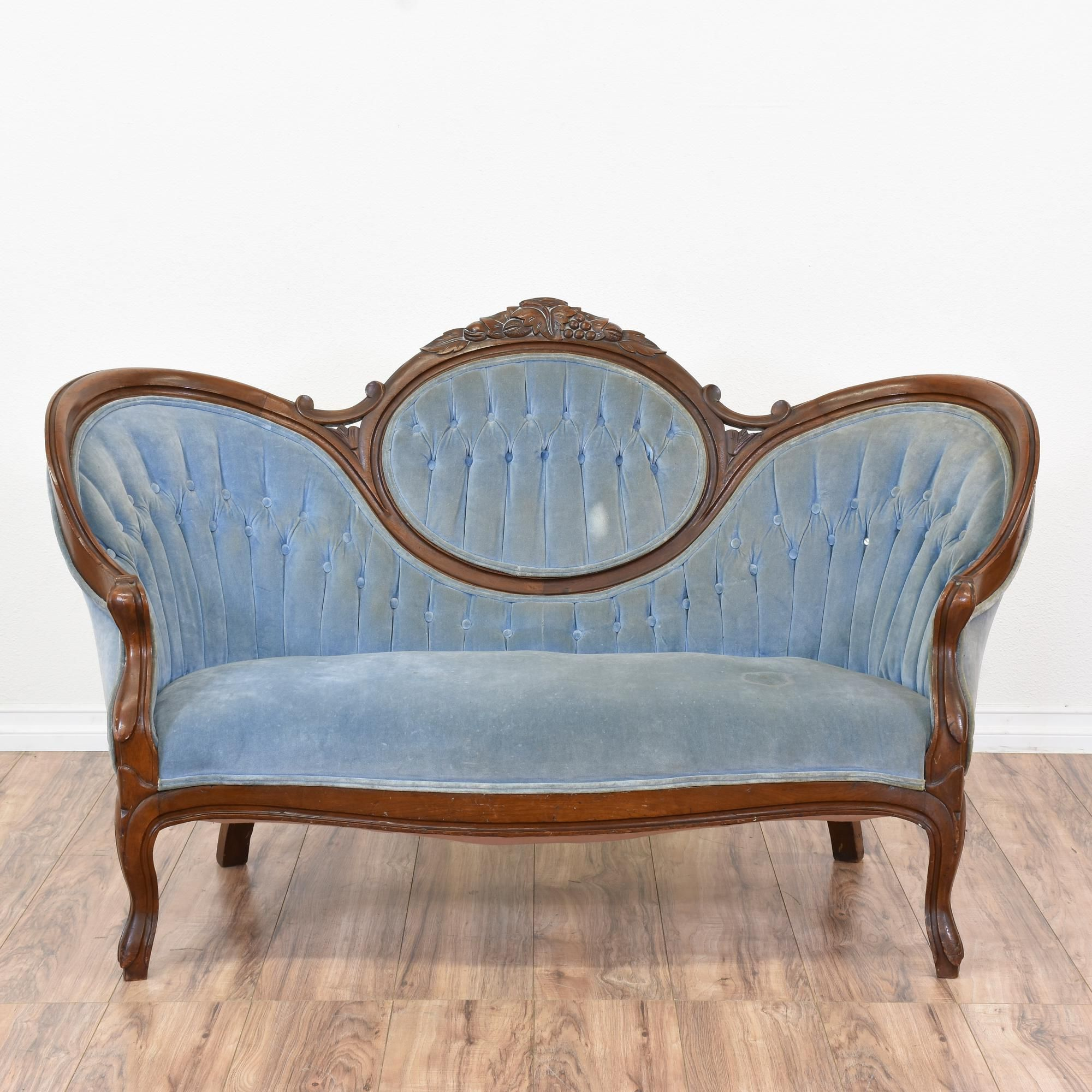 This victorian sofa is upholstered in a durable light blue velvet