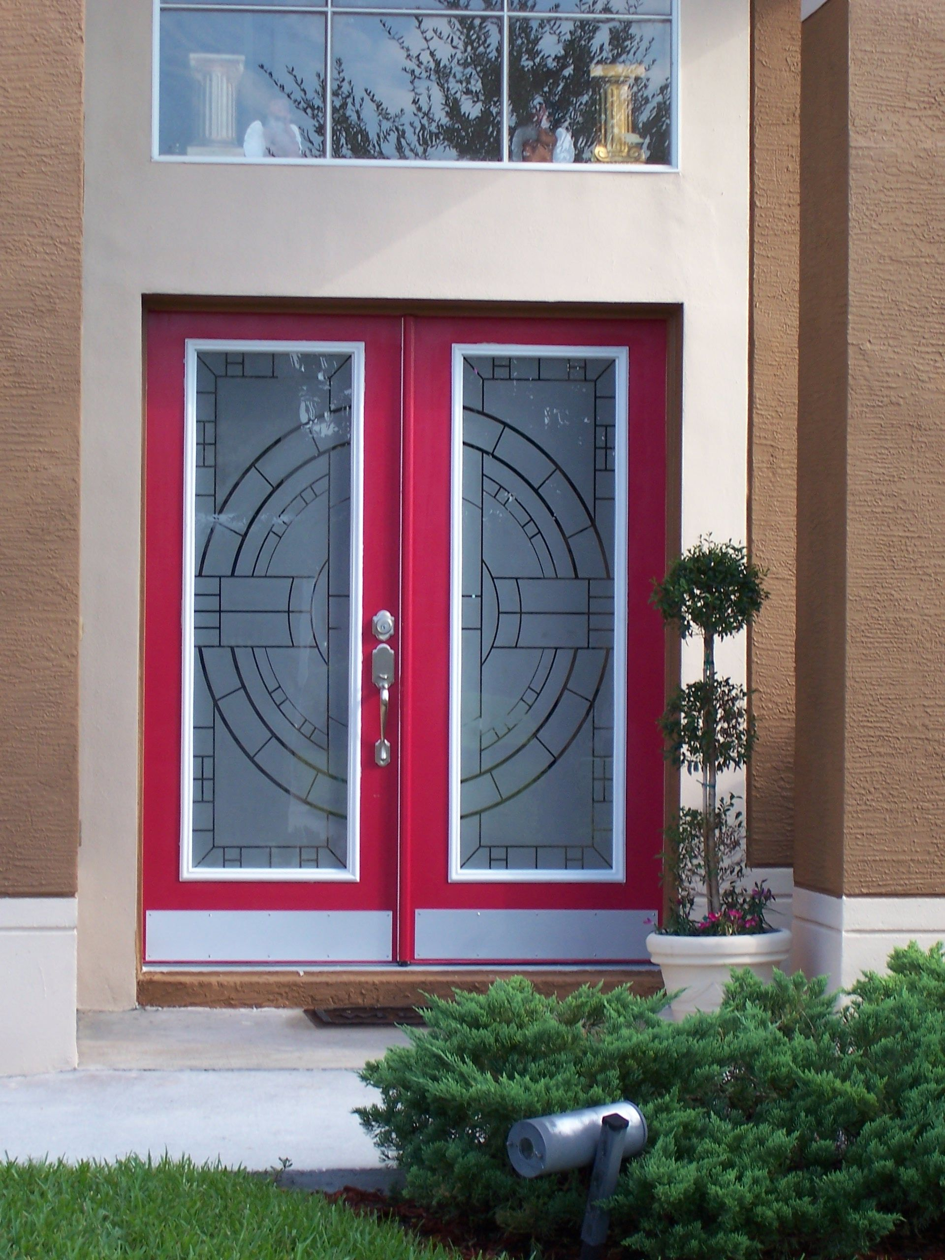 Red Doors With A Geometric Modern Etched Glass Design Painted Front Doors Front Door Design Red Brick House