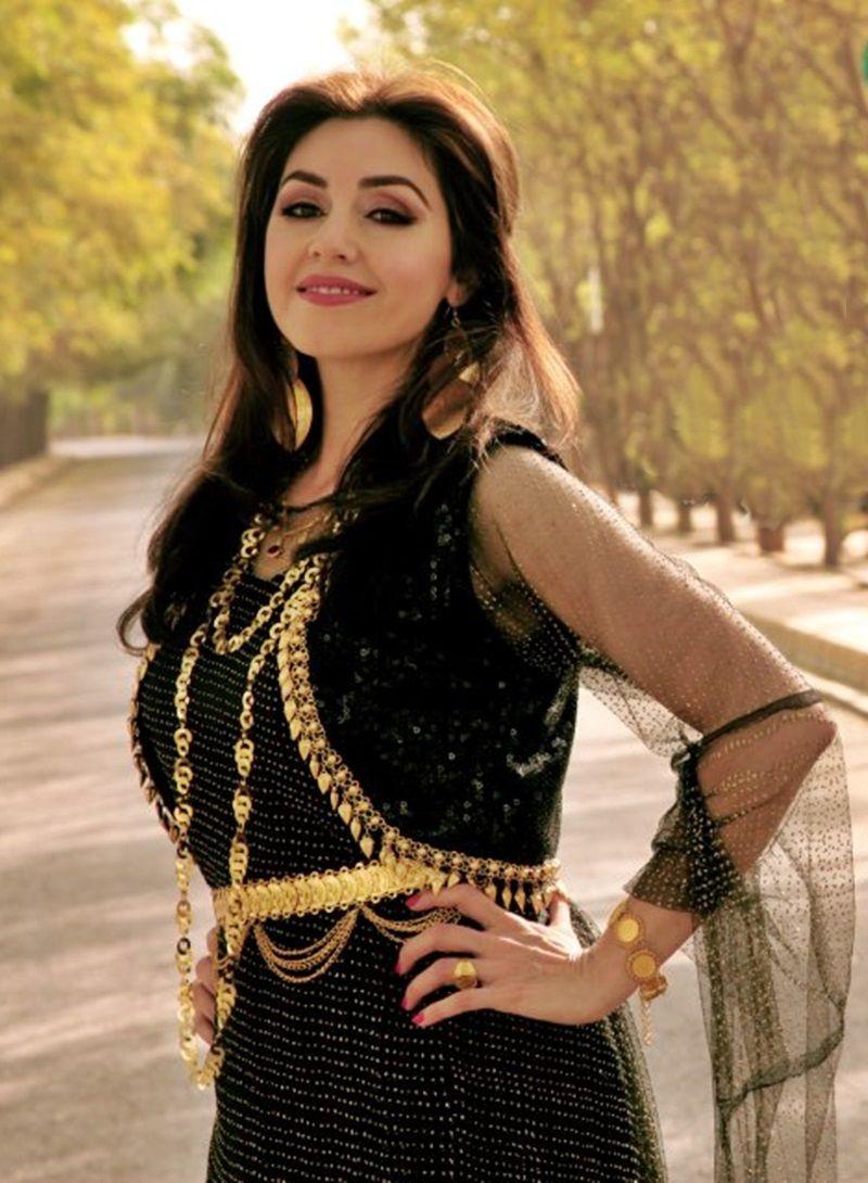Nadia kurdish singer in a kurdish black dress with golden
