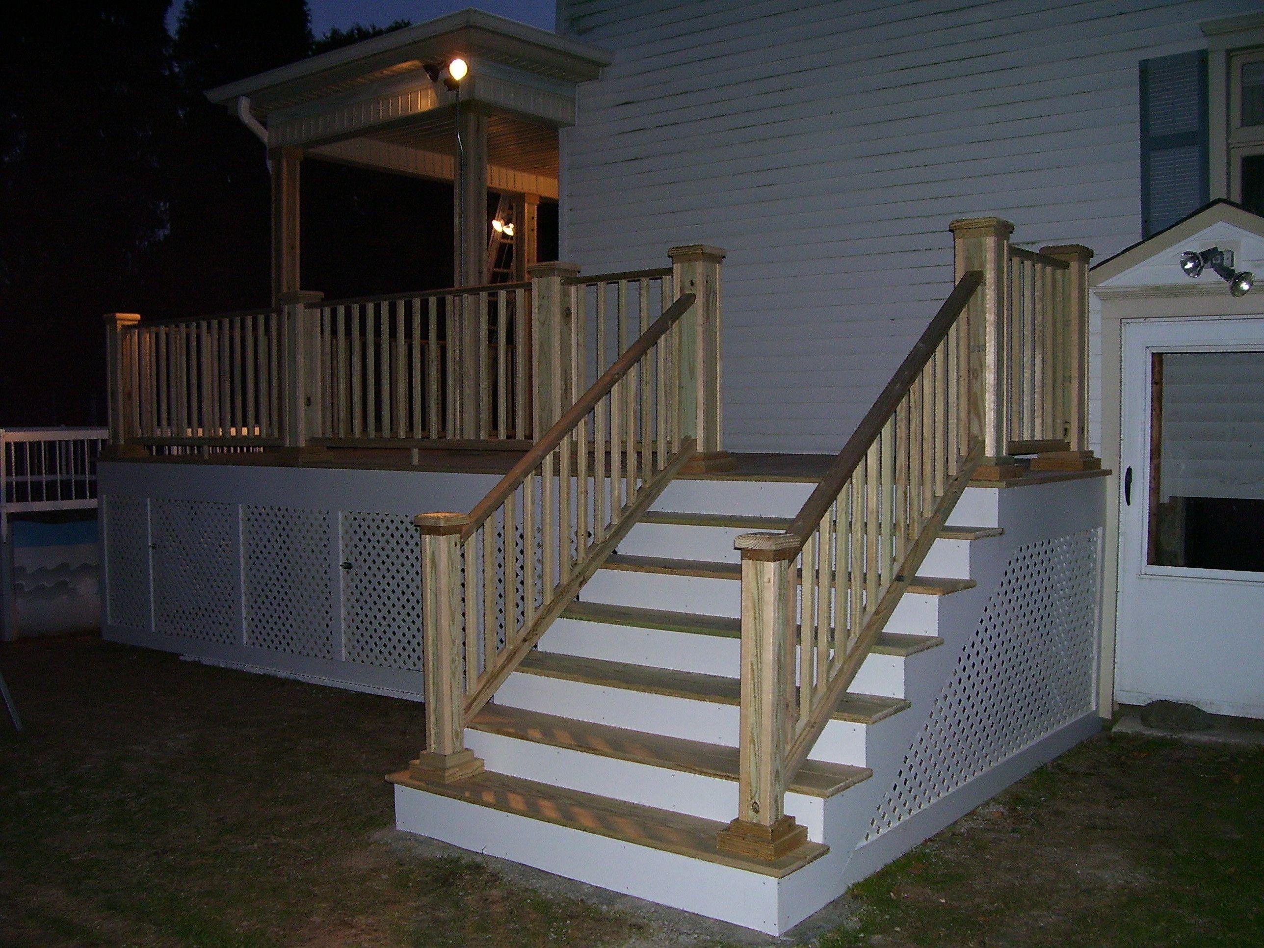 All pressure treated deck with vinyl lattice enclosure the porch